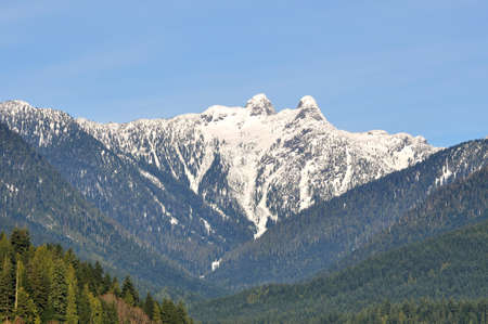 snowcapped: Snow-capped Crown Mountain in winter Stock Photo