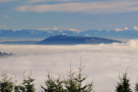 arise: mountains arising up from sea of clouds