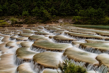 These unique step waterfalls are located in the Yulong mountain range near Lijian, Yunnan, China