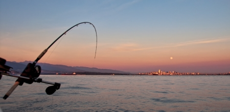 Trolling for salmon from a boat along the shores of Vancouver