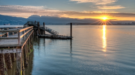 Pier on the left side and sunstar on the right   HDR is used to maintain detail in the pier