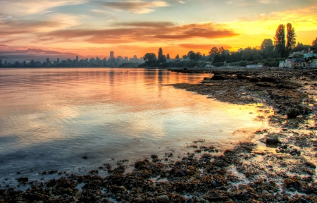 This vivid sunrise over Vancouver with the bay in the foreground is a beautiful landscape