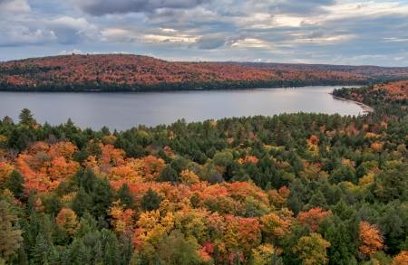 View of Rock lake pointing into the distance with Autumn trees changing colors around the lake