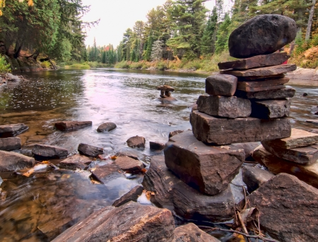 Rocks stacked  on a river in Algonquin park during the fall