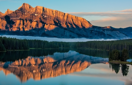 View across two jack lake from Lake Minnewanka Scenic Drive at sunrise in Banff National Park  photo