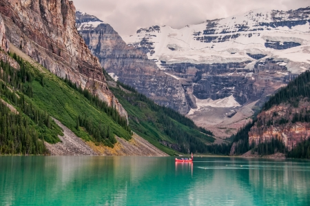 Photo of canoe on Lake Louise with glacier in the background