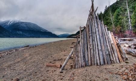 Wooden hut build along side lake