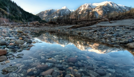 british columbia: River side pool contains perfect mountain reflect  Stock Photo