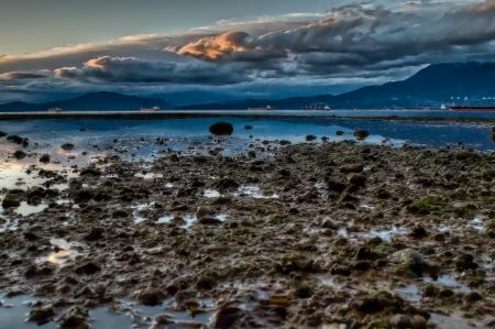 Dramatic dark clouds over a seaside landscape photo