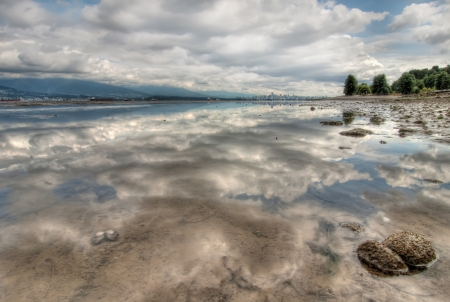 Vancouver Skyline in distance with perfect cloud reflection Stock Photo