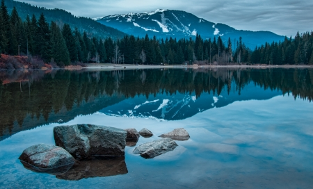 Whistler mountain reflected in lost lake with a blue hue