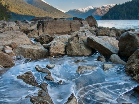 whistler: Ice along shore of Cheakamus Lake with mountain in distance