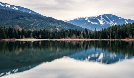 The mountain on the right is Whistler, the one on the right is Blackcomb   Both reflected in lost lake not far from Whistler village  Stock Photo