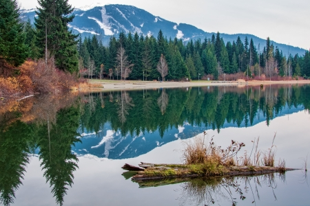 Whistler mountain looks so peaceful reflected in Lost Lake early in the morning  Standard-Bild