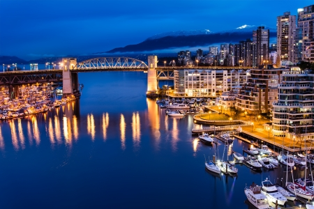 Vancouver Skyline and Burrard Street Bridge at Night Stock Photo