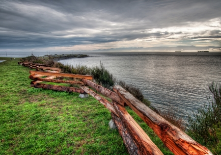 Ocean shore with wooden fence in Victoria Stock Photo