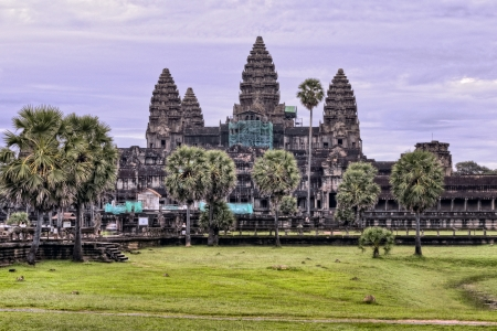 Purple sunrise behind Angkor Wat temple photo