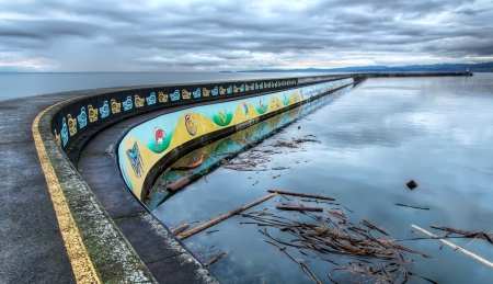 Native mural on the side of a public pier