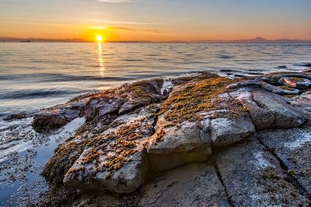 british columbia: Rocky Shore with Golden Sunrise