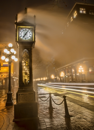 Car light streaks next to Gastown steam clock in Vancouver photo