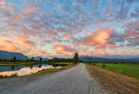 Amazing clouds above gravel path  Stock Photo