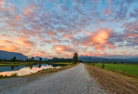 Amazing clouds above gravel path  Standard-Bild