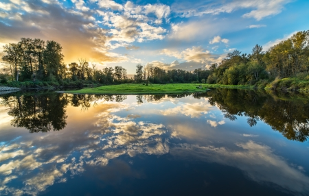 hdr: River reflection of clouds over wide angle  Stock Photo