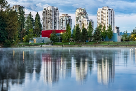 Lake with trees and condo buildings