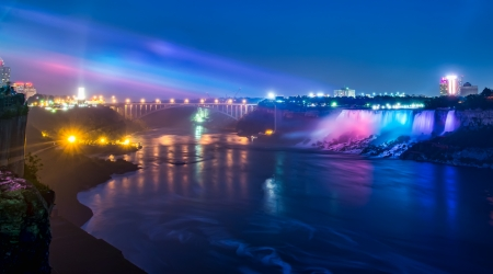 Evening lights at Niagara falls with Bridge