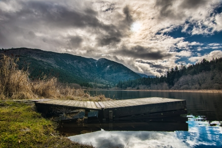 hot springs: Dramatic clouds with dock on a lake Stock Photo