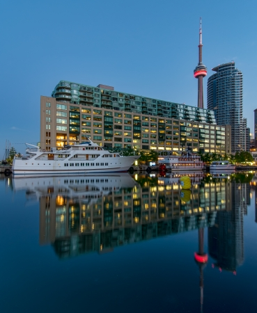 Toronto harbour with CN tower and reflection  photo