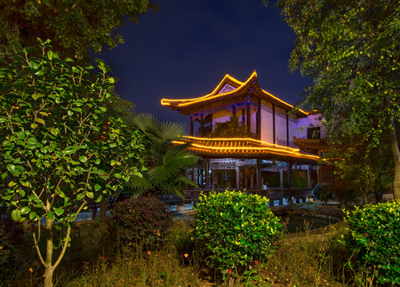 Night photo of a Chinese building in a park