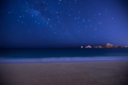 Cabo San Lucas stars and beach over ocean.