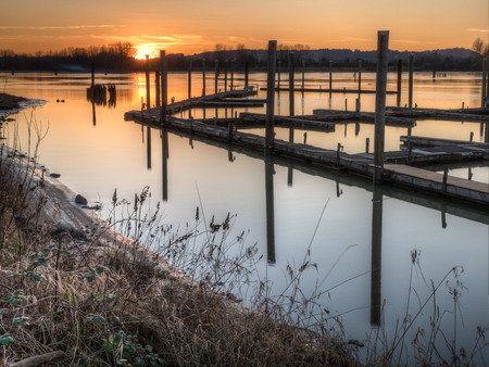 Sunset with a riverside dock