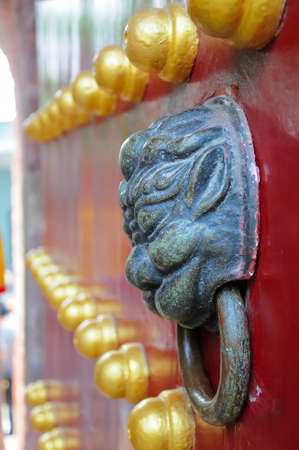 Red gate with old tiger knocker,Lotus Castle,GuangZhou,China  photo