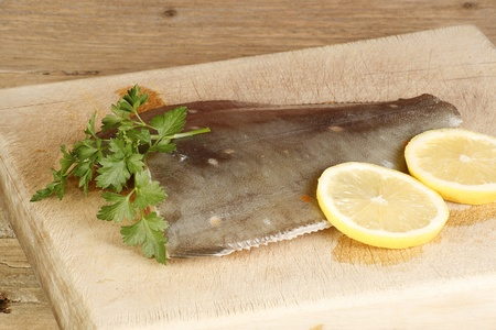 plaice: fillet of plaice on cutting board with garnish