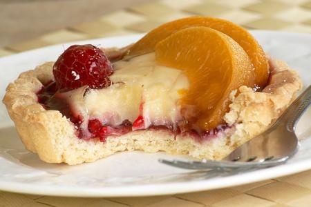 melba: Melba persona tarta con crema y rapberries paches