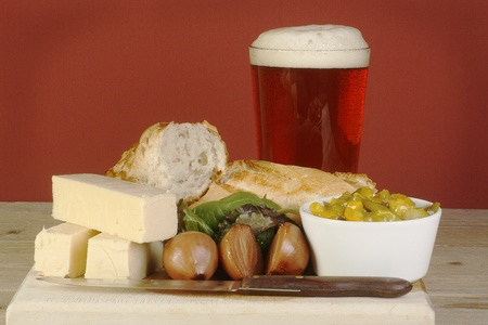 ploughmans lunch of cheese picles and crusty bread with a pint of real ale