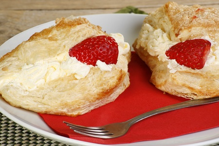 flakey pastry cakes filled with whipped cream apple and strawberries Stock Photo - 12136344