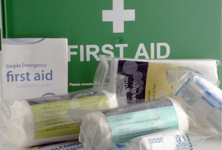 first aid box: Green first aid box and contents