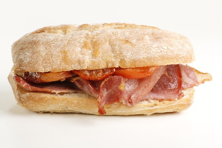 crust crusty: crispy grilled bacon and tomato on a crusty bread roll