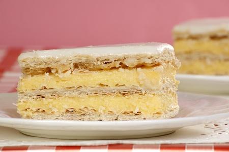 iced vanilla slice cake with custard filling