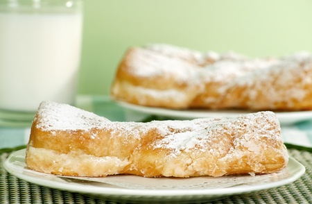 twists: two fresh baked doughnut twists on a green tablecloth Stock Photo