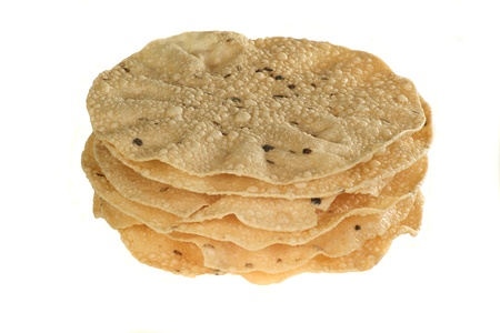 indian food stack of spiced poppadoms isolated on a white background Stock Photo