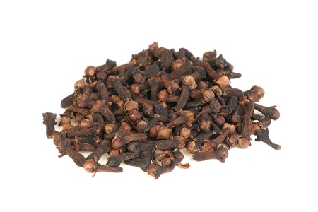 clove of clove: whole spice pile of whole cloves isolated on a white background Stock Photo