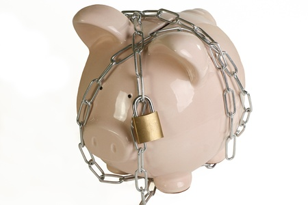 padlocked: security concept pink ceramic piggy bank chained and padlocked on a white background Stock Photo