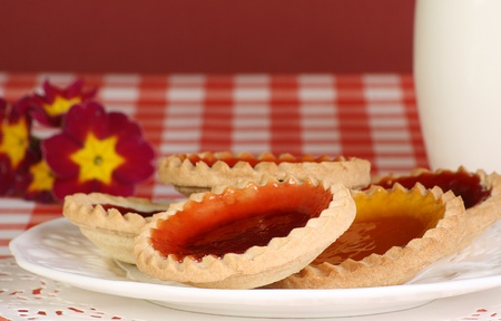 jam tarts: delicious jam tarts on a plate with milk