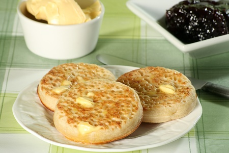 toasted crumpets with, damson jam and butter photo