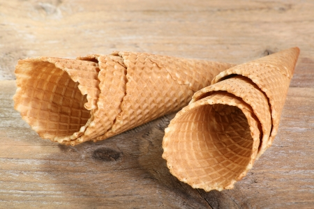 ice cream cones on a weathered wood background Stock Photo