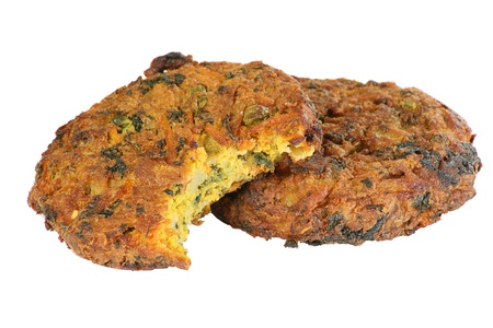 spiced vegetable bhajis isolated on white photo